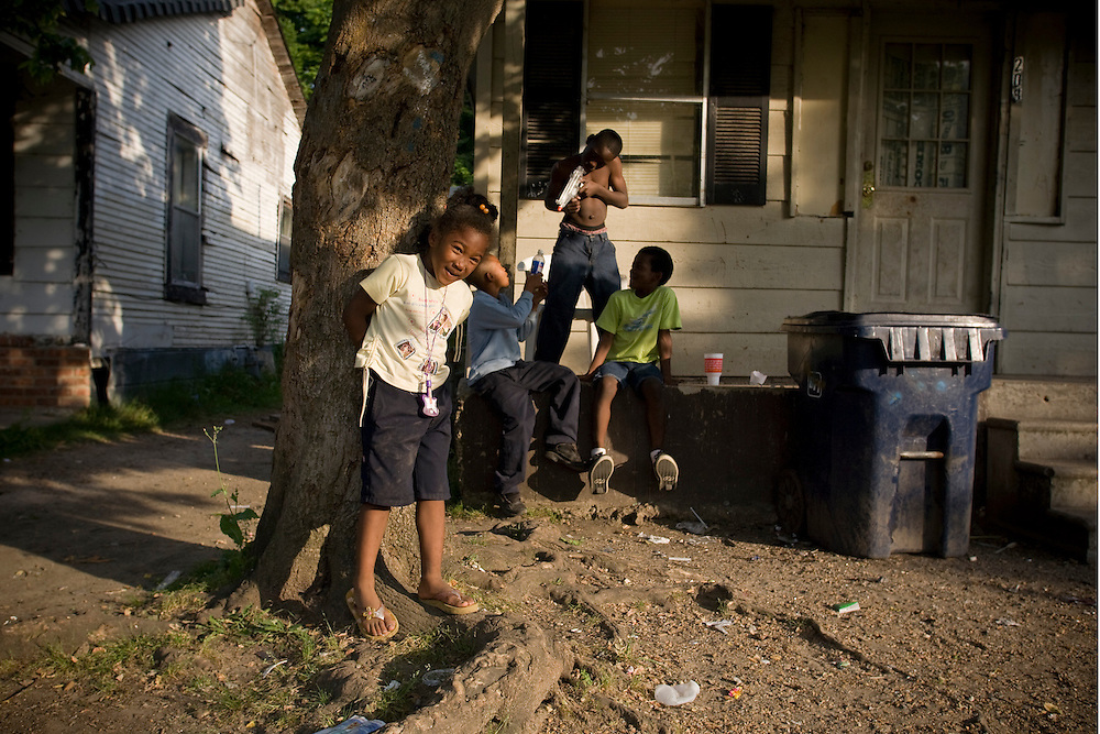 Children play along 11th street in Clarksdale, Miss., 2007. Shakai Nor, 5, standing near the tree. <br /> Photo by D.L. Anderson