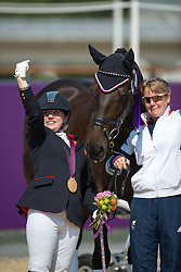 Baker Natasha (GBR) (GBR) congratulates her horse Cabral after winning the Gold Medal  in the Individual Freestyle - Grade II Dressage <br /> London 2012 Paralympic Games<br /> © Hippo Foto - Jon Stroud