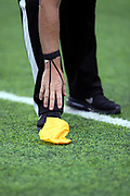 An NFL official reaches to pick up a penalty flag during the Minnesota Vikings NFL week 6 regular season football game against the Arizona Cardinals on Sunday, Oct. 14, 2018 in Minneapolis. The Vikings won the game 27-17. (©Paul Anthony Spinelli)