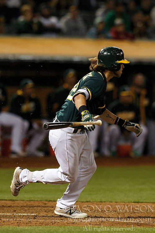 OAKLAND, CA - JULY 19:  Josh Reddick #22 of the Oakland Athletics hits a walk off single against the Houston Astros during the tenth inning at the Oakland Coliseum on July 19, 2016 in Oakland, California. The Oakland Athletics defeated the Houston Astros 4-3 in 10 innings.  (Photo by Jason O. Watson/Getty Images) *** Local Caption *** Josh Reddick