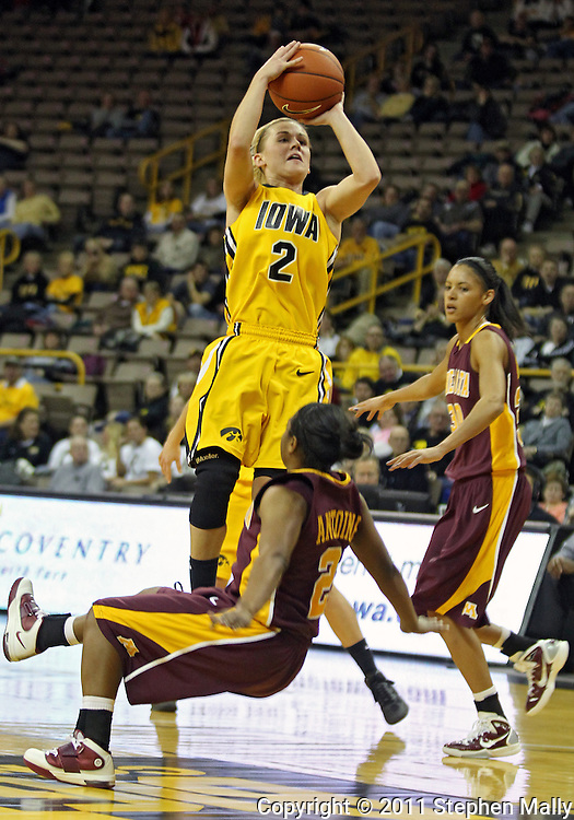 February 10 2011: Iowa Hawkeyes guard Kamille Wahlin (2) puts up a shot as Minnesota Golden Gophers guard China Antoine (2) falls during the first half of an NCAA women's college basketball game at Carver-Hawkeye Arena in Iowa City, Iowa on February 10, 2011. Iowa defeated Minnesota 64-62.