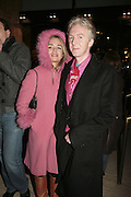 Lisa Saxton and Philip Treacy, Cirque de Soleil Premiere of Alegr'a. Royal Albert Hall. London. 5 January 2006.  -DO NOT ARCHIVE-© Copyright Photograph by Dafydd Jones. 248 Clapham Rd. London SW9 0PZ. Tel 0207 820 0771. www.dafjones.com.