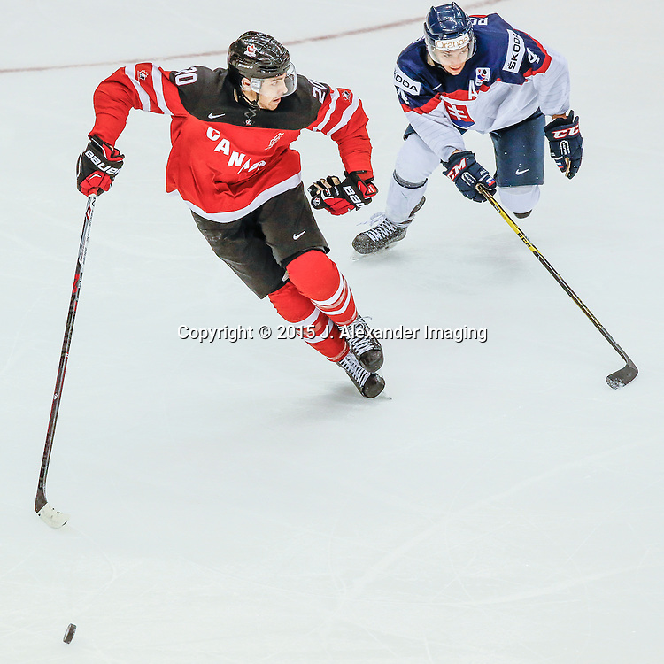 Team Canada and Team Slovakia players rush to the puck during the 2015 IIHF Junior World Championships.
