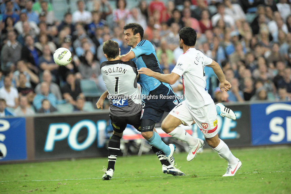 29.12.2011 Sydney, Australia.Sydney forward  Bruno Cazarine and Melbourne Heart goalkeeper Clint Bolton collide during the A-League game between Sydney FC and Melbourne Heart played at the Sydney Football Stadium.