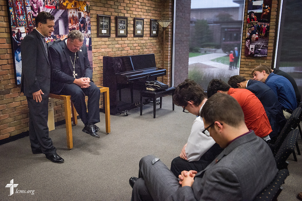 The Rev. Dr. Matthew C. Harrison, president of The Lutheran Church–Missouri Synod, prays with Pre-Seminary Program students and the Rev. Dr. Jeffrey Leininger, Concordia University Chicago campus pastor and pre-seminary director, during a brief meeting on the university campus in River Forest, Ill., on Sunday, Oct. 12, 2014. LCMS Communications/Erik M. Lunsford