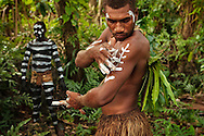 Ni Vanuatu man painting himself for the snake dance. The snake dance is a traditional dance which takes place on special occations for the inhabitabts of Rah Lava Island. These days it is often performed for the visiting tourists. Rah Lava Island, Torba Province, Vanuatu