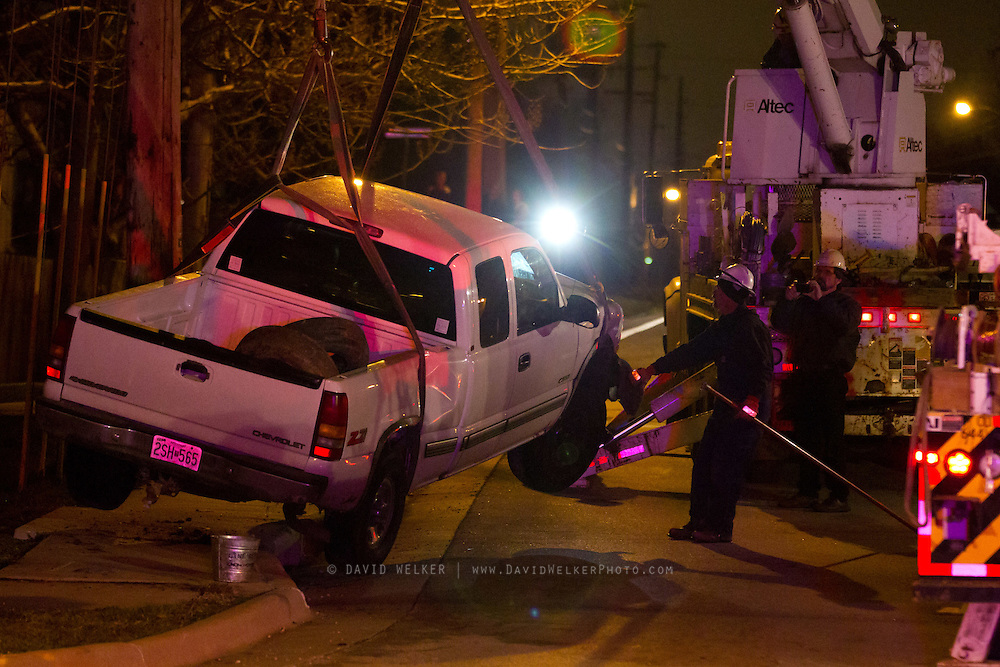 March 29 2011: Accident at South Golden Ave. and Farm Road 164 in Southwest Springfield. A pick up truck is stuck on the guy wires after crashing. The driver left the scene prior to the arrival of emergency crews. Credit: David Welker / TurfImages.com.