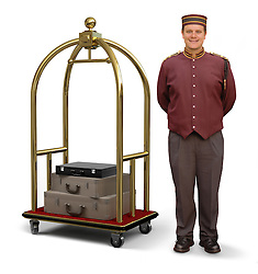 Bellhop in retro uniform and luggage cart on a white background with clipping path on bellman