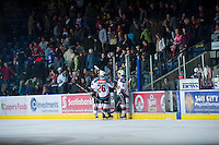 KELOWNA, CANADA - DECEMBER 30:  Tyrell Goulbourne #12, Cole LInaker #26 and Jesse Lees #2 of the Kelowna Rockets celebrate the win Everett Silvertips at the Kelowna Rockets on December 30, 2012 at Prospera Place in Kelowna, British Columbia, Canada (Photo by Marissa Baecker/Shoot the Breeze) *** Local Caption ***