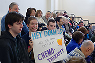 "Westbury, New York, USA. January 15, 2017. BRIDGIT SQUITIRE, of West Islips holds a sign asking ""HEY DONALD, ARE YOU GONNA PAY FOR MY CHEMO-THERAPY?"" at the ""Our First Stand"" Rally against Republicans repealing the Affordable Care Act, ACA, taking millions of people off health insurance, making massive cuts to Medicaid, and defunding Planned Parenthood. Hosts were Reps. K. Rice (Democrat - 4th Congressional District) and T. Suozzi (Dem. - 3rd Congress. Dist.)."