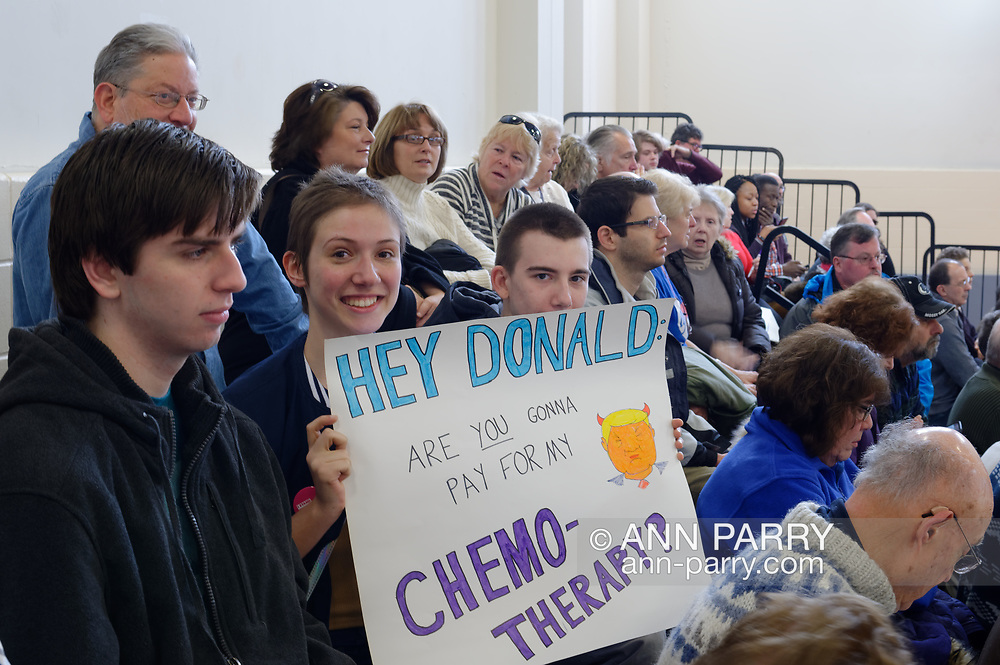"""Westbury, New York, USA. January 15, 2017. BRIDGIT SQUITIRE, of West Islips holds a sign asking """"HEY DONALD, ARE YOU GONNA PAY FOR MY CHEMO-THERAPY?"""" at the """"Our First Stand"""" Rally against Republicans repealing the Affordable Care Act, ACA, taking millions of people off health insurance, making massive cuts to Medicaid, and defunding Planned Parenthood. Hosts were Reps. K. Rice (Democrat - 4th Congressional District) and T. Suozzi (Dem. - 3rd Congress. Dist.)."""