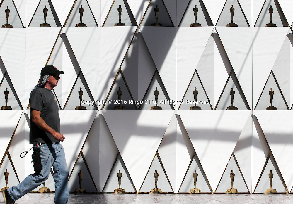 A worker walks by the backdrop for the arrivals area for the Oscars in front of the Dolby Theatre in Los Angeles, Wednesday, February 24, 2016. The 88th Academy Awards will be held Sunday, February 28, 2016. (Photo by Ringo Chiu/PHOTOFORMULA.com)<br /> <br /> Usage Notes: This content is intended for editorial use only. For other uses, additional clearances may be required.
