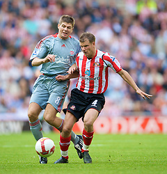 SUNDERLAND, ENGLAND - Saturday, August 16, 2008: Liverpool's captain Steven Gerrard MBE and Sunderland's Teemu Tainio during the opening Premiership match of the season at the Stadium of Light. (Photo by David Rawcliffe/Propaganda)