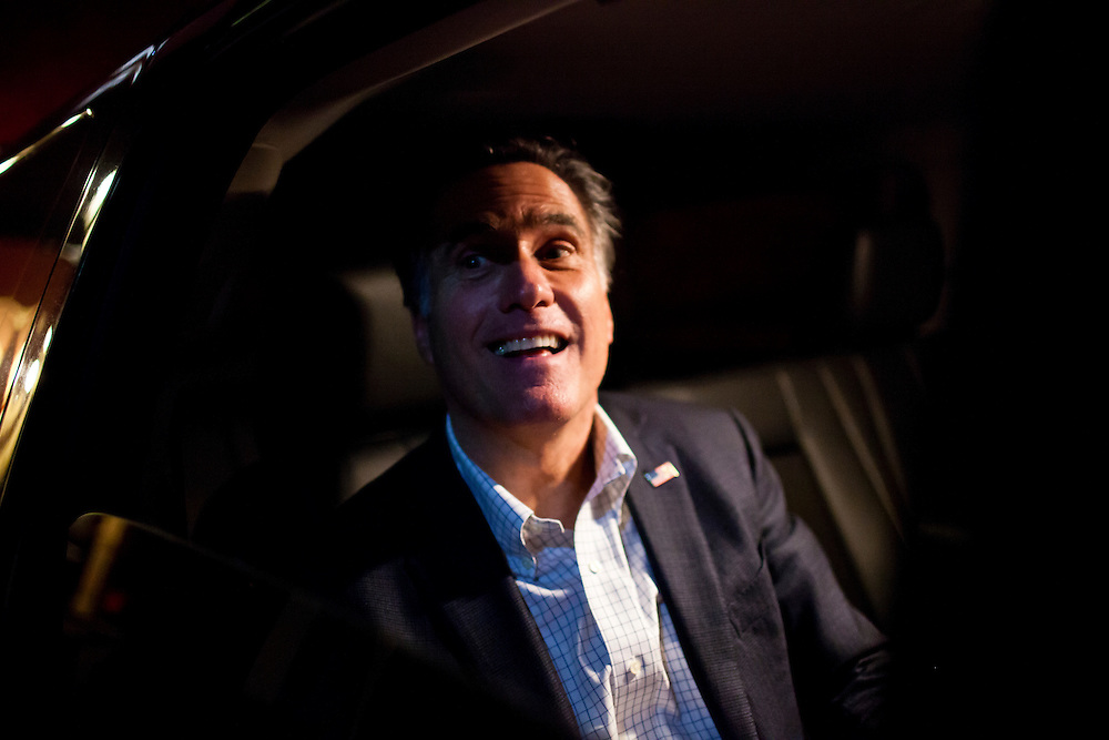 Republican presidential candidate Mitt Romney signs autographs from inside his SUV after hosting a spaghetti dinner on Friday, January 6, 2012 in Tilton, NH.