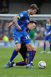 Bristol Rovers' Ollie Clarke challenges AFC Wimbledon's Harry Pell - Photo mandatory by-line: Dougie Allward/JMP - Mobile: 07966 386802 05/04/2014 - SPORT - FOOTBALL - Kingston upon Thames - Kingsmeadow - AFC Wimbledon v Bristol Rovers - Sky Bet League Two