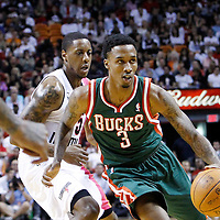 22 January 2012: Milwaukee Bucks point guard Brandon Jennings (3) drives past Miami Heat point guard Mario Chalmers (15) during the Milwaukee Bucks 91-82 victory over the Miami Heat at the AmericanAirlines Arena, Miami, Florida, USA.