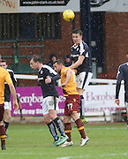 Dundee&rsquo;s Thomas Konrad towers above Motherwell&rsquo;s Theo Robinson as he heads clear - Dundee v Motherwell, Ladbrokes Premiership at Dens Park <br /> <br />  - &copy; David Young - www.davidyoungphoto.co.uk - email: davidyoungphoto@gmail.com