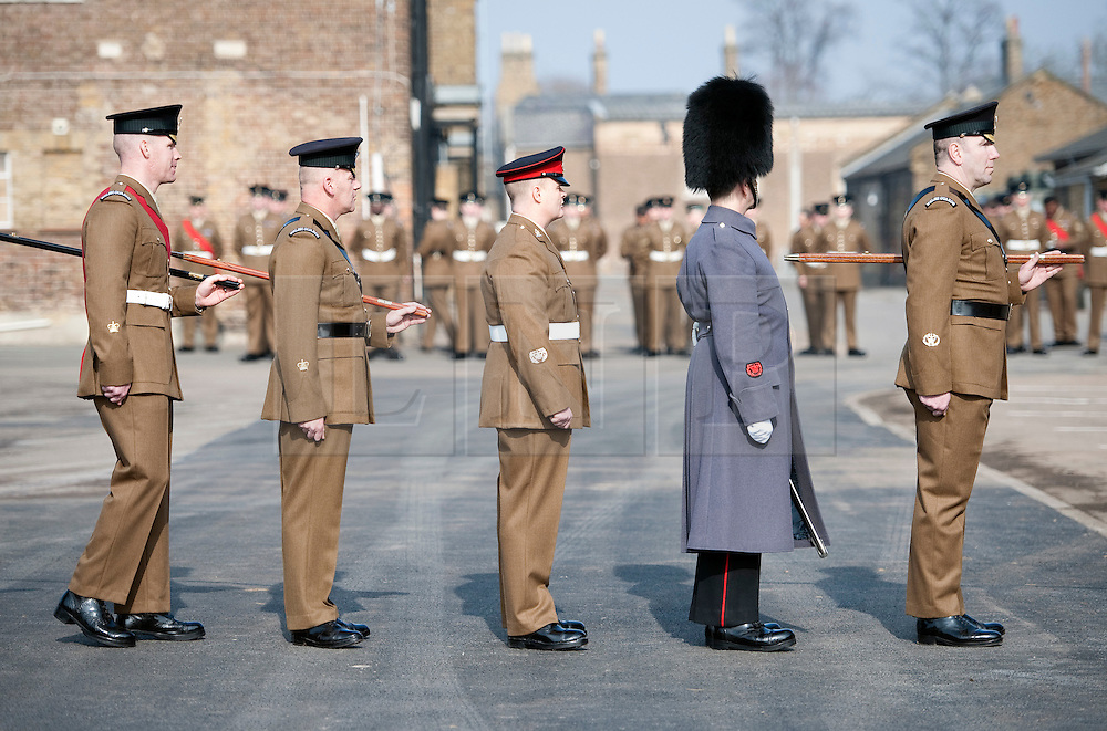© Licensed to London News Pictures. 01/03/2012. Hounslow, UK.  Members of  The Welsh Guards queue to be presented a leek by HRH  Prince Charles at Cavalry Barracks,  Hounslow, London on St David's Day, March 1st, 2012.  Two-thirds of the Battalion's 600 soldiers are due to be deployed to Afghanistan in the next two weeks. Photo credit : Ben Cawthra/LNP