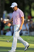 Sang-Moon Bae celebrates hsi par putt on the 18th hole during the final round of the Transitions Chapionship on the Cooperhead Course at Innisbrook Resort and Golf Club on March 18, 2012 in Palm Harbor, Fla. ..©2012 Scott A. Miller.