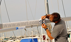 Final touches are applied to the J80 fleet used by the Match Race France organisers. Chris Davies/WMRT