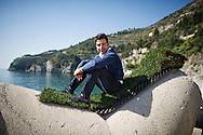Cetara, Italia - 18 marzo 2012. Vittorio Sangiorgio, 29 anni, ritratto sulla spiaggia di Cetara, piccolo paese della costiera amlfitana (le zolle di erba sulle quali e steso e quella che viene utilizzata dalla sua azienda  per creare i giardini pensili). Vittorio e un giovane imprenditore che ha un'azienda specializzata nella crezione di giardini pensili e rivestimenti in erba al posto dei normali tetti..Ph. Roberto Salomone Ag. Controluce.ITALY - Vittorio Sangiorgio, 29, portrayed on the beach of Cetara on the Amalfi coast on March 18, 2012. Mr. Sangiorgio is CEO of a company specialized in the creation of rooftop gardens.