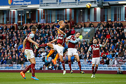 Paul McShane of Hull City heads a shot over the bar as George Boyd of Burnley challenges him y - Photo mandatory by-line: Rogan Thomson/JMP - 07966 386802 - 08/11/2014 - SPORT - FOOTBALL - Burnley, England - Turf Moor Stadium - Burnley v Hull City - Barclays Premier League.