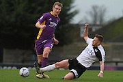 Connor Clifford tackles Kyle Storer during the Vanarama National League match between Boreham Wood and Cheltenham Town at Meadow Park, Boreham Wood, United Kingdom on 9 January 2016. Photo by Antony Thompson.