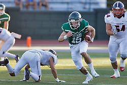 {BLOOMINGTON, IL: Dean Zigulich during a college football game between the IWU Titans  and the Wheaton Thunder on September 15 2018 at Wilder Field in Tucci Stadium in Bloomington, IL. (Photo by Alan Look)