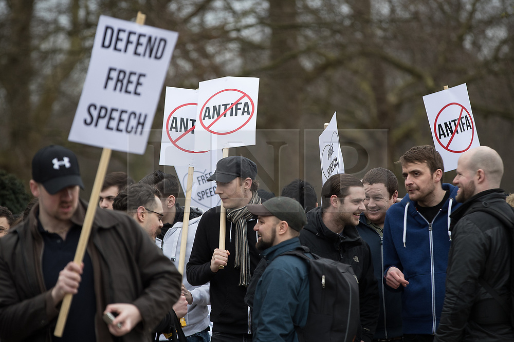 "© Licensed to London News Pictures. 11/03/2018. London, UK. Alt-right supporters with an anti antifa and "" Defend free speech "" placards . Alt right group Generation Identity and other far-right groups hold a demonstration at Speakers' Corner in Hyde Park , opposed by antifascists . Generation Identity supporters Martin Sellner and Brittany Pettibone were due to speak at the demo but were arrested and detained by police when they arrived in the UK , also forcing them to cancel an appearance at a UKIP "" Young Independence "" youth event , which in turn was reportedly cancelled amid security concerns . Photo credit: Joel Goodman/LNP"
