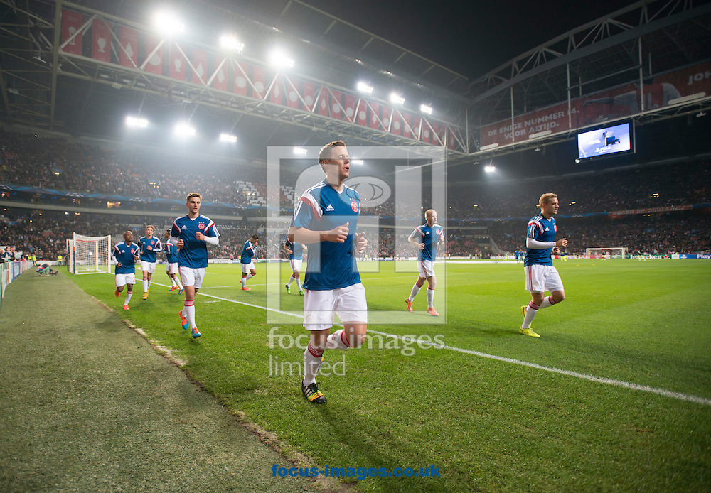 Ajax players warm up before the UEFA Champions League match at Amsterdam Arena, Amsterdam<br /> Picture by Russell Hart/Focus Images Ltd 07791 688 420<br /> 05/11/2014