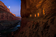 The moon rises above the Nankoweap granaries and the Colorado River in Marble Canyon. Grand Canyon National Park in Arizona.