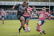 Iliess Macani (Bradford Bulls) goes to kick the ball through past the Oldham Roughyeds player during the Kingstone Press Championship match between Oldham Roughyeds and Bradford Bulls at Bower Fold, Oldham, United Kingdom on 2 April 2017. Photo by Mark P Doherty.