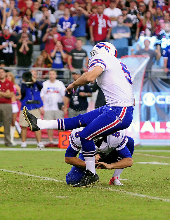 Oct. 14, 2012; Glendale, AZ, USA; Buffalo Bills place kicker Rian Lindell (9) kicks the game winning field goal in overtime against the Arizona Cardinals at University of Phoenix Stadium. The Bills defeated the Cardinals 19-16 in overtime. Mandatory Credit: Jennifer Stewart-US PRESSWIRE.