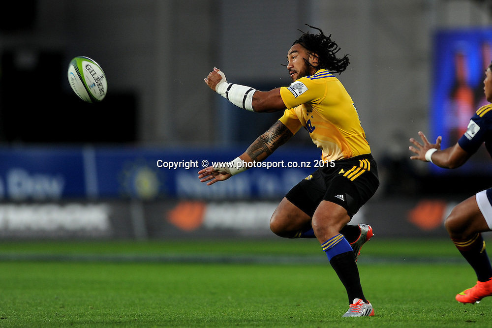 Ma'a Nonu of the Hurricanes makes a pass, during the Super Rugby Match between the Highlanders and the Hurricanes, at Forsyth Barr Stadium, Dunedin, New Zealand, 20 March 2015. Credit: Joe Allison / www.photosport.co.nz
