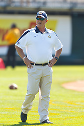 September 17, 2011; San Francisco, CA, USA;  California Golden Bears head coach Jeff Tedford watches his team warm up before the game against the Presbyterian Blue Hose at AT&T Park.  California defeated Presbyterian 63-12.