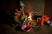 Mforo, Tanzania a village near Moshi, Tanzania.<br /> Solar Sister entrepreneur Fatma Mziray cooking dinner on her clean cookstove that uses wood.                                                 Fatma Mziray is a Solar Sister entrepreneur who sells both clean cookstoves and solar lanterns. Fatma heard about the cookstoves from a Solar Sister development associate and decided to try one out. The smoke from cooking on her traditional wood stove using firewood was causing her to have a lot of heath problems, her lungs congested her eyes stinging and her doctor told her that she had to stop cooking that way. Some days she felt so bad she couldn't go in to cook. Fatma said, &ldquo;Cooking for a family, preparing breakfast, lunch and dinner I used to gather a large load of wood every day to use. Now with the new cook stove the same load of wood can last up to three weeks of cooking. <br /> <br /> &ldquo;With the extra time I can develop my business. I also have more time for the family. I can monitor my children&rsquo;s studies. All of this makes for a happier family and a better relationship with my husband. Since using the clean cookstove no one has been sick or gone to the hospital due to flu.&rdquo;  Fatma sees herself helping her community because she no longer sees the people that she has sold cookstoves have red eyes, coughing or sick like they used to be. She has been able to help with the school fees for her children, purchase items for the home and a cow.<br /> <br /> &ldquo;What makes me wake up early every morning and take my cookstoves and go to my business is to be able to take my family to school as well as to get food and other family needs.&rdquo;