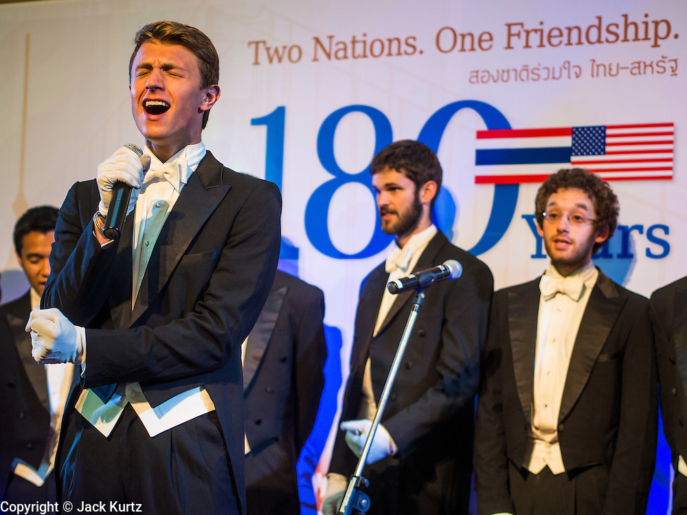 """19 JULY 2013 - BANGKOK, THAILAND:  HENRY GOTTFRIED, a  Yale senior theater studies major, fronts the Whiffenpoofs during their show in Bangkok Friday. The Yale Whiffenpoofs, one of the best-known collegiate a cappella groups in the world performed in CentralWorld in Bangkok Friday. Founded in 1909, the """"Whiffs"""" began as a senior quartet that met for weekly concerts at Mory's Temple Bar, the famous Yale tavern. The Bangkok stop was a part of their 2013 world tour and was sponsored by the US Embassy. They sang at the opening of a photo exhibit that marked 180 years of friendly diplomatic relations between Thailand and the United States.    PHOTO BY JACK KURTZ"""