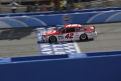 "FONTANA, CA - MARCH 26  Kyle Larson, driver of the No. 42 Target Chevrolet, wins the Monster Energy NASCAR Cup Series Auto Club 400 at Auto Club Speedway. Larson took the checkered flag at the end of the second extra lap as team owner Chip Ganassi celebrated from his perch atop the pit box. ""It's great to be Kyle Larson right now,"" said the 24-year-old driver.. 2017 march 26.  Byline, credit, TV usage, web usage or link back must read SILVEXPHOTO.COM. Failure to byline correctly will incur double the agreed fee. Tel: +1 714 504 6870."