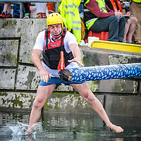 JJ Crowley, Ballinadee makes a grab for the flag on his way to winning the Greasy Pole competition at the Water Carnival on Bank Holiday  Monday at the Kinsale Regatta.<br /> Picture. John Allen