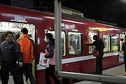 railway commuters after dark Japan