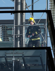 © Licensed to London News Pictures. 06/06/2018. London, UK. A fire officer is seen on the stairs of the exclusive One Hyde Park appartment block next to the Mandarin Oriental hotel during a fire. Fifteeen fire engines and 97 firefighters and officers have been called to a fire believed to be at the Mandarin Hotel in Kightsbridge. Photo credit: Peter Macdiarmid/LNP