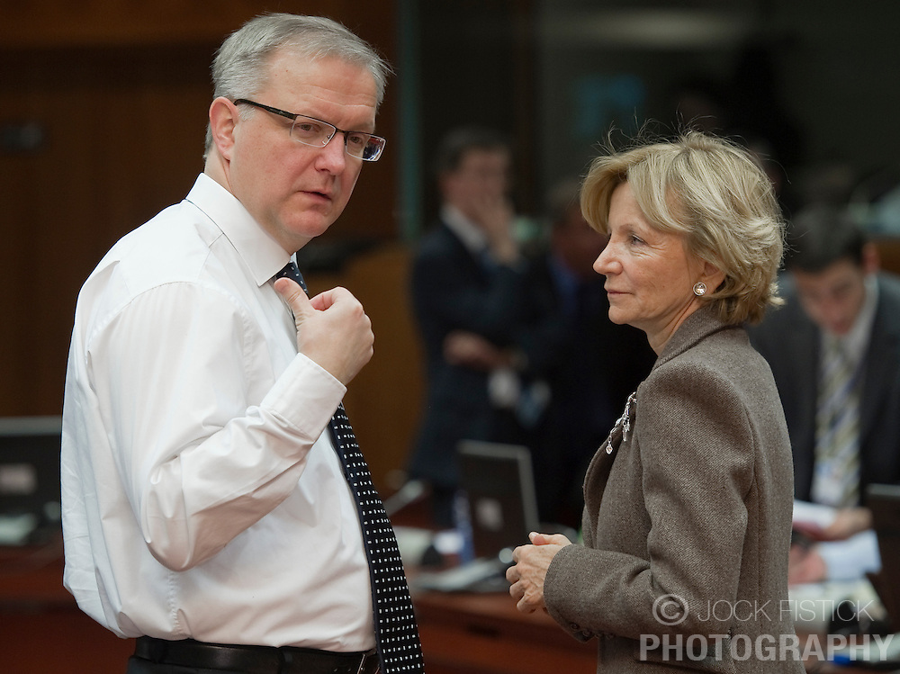 Olli Rehn, The EU's economic and monetary affairs commissioner, left, speaks with Elena Salgado, Spain's finance minister, during the meeting of European Union finance ministers, at the EU headquarters in Brussels, Belgium, on Tuesday, March 16, 2010. (Photo © Jock Fistick)