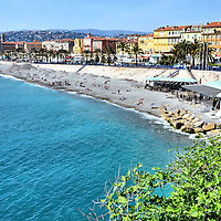 Bay of Angels Coastline in Nice, France <br /> This gorgeous view of the Mediterranean coast in Nice epitomizes the French Riviera's beauty.  It is called Baie des Anges or Bay of Angels.  I assumed it derived its name from the angelic atmosphere offered by the warm sunshine, the beaches and the promenades.  However, the origin comes from the squatina angelus, a shark that has two fins shaped like angel wings. But don't worry … it has not been seen in these waters since the 19th century.
