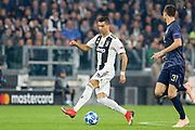 Juventus Forward Cristiano Ronaldo step over as he takes on Manchester United Midfielder Nemanja Matic during the Champions League Group H match between Juventus FC and Manchester United at the Allianz Stadium, Turin, Italy on 7 November 2018.
