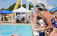 Lion Swim Club's Shelby Michels, 12, cheers on her team in the Girls 11-12 200 Yard Freestyle Relay event at the All City Swim Meet at Cherry Hill Aquatic Center in Cedar Rapids on Saturday, July 20, 2013. 623 athletes from ages 4-17 participated in the meet.