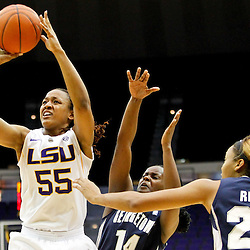November 16, 2011; Baton Rouge, LA; LSU Tigers forward LaSondra Barrett (55) shoots as Georgetown Hoyas guard Sugar Rodgers (14) and forward Amanda Reese (24) defend during the first half of a game at the Pete Maravich Assembly Center.  Mandatory Credit: Derick E. Hingle-US PRESSWIRE