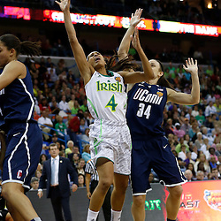 April 7, 2013; New Orleans, LA, USA; Notre Dame Fighting Irish guard Skylar Diggins (4) shoots against Connecticut Huskies guard Kelly Faris (34) during the first half in the semifinals during the 2013 NCAA womens Final Four at the New Orleans Arena. Mandatory Credit: Derick E. Hingle-USA TODAY Sports