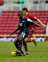 Photo: Leigh Quinnell.<br /> Middlesbrough v Manchester City. The Barclays Premiership. 31/12/2005. Man Citys Nedum Onuoha is put under presure from Middlesbroughs  Emanuel Pogatetz.