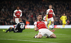 Arsenal's Sokratis Papastathopoulos (left) celebrates scoring his side's third goal of the game during the UEFA Europa League round of 32 second leg match at the Emirates Stadium, London.