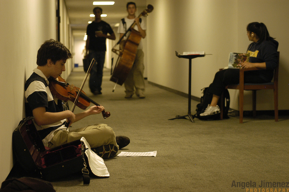 Young classical music students in the Pre-College Division program at The Juilliard School of music rehearse in the hallway for their seating auditions, which will determine their places in the school's orchestra, during their weekly courses and lessons at the school, located at West 65th Street and Broadway in New York City, on Saturday, September 24, 2005. Students audition for spots in the prestigious program, in which they can study until they graduate from high school.